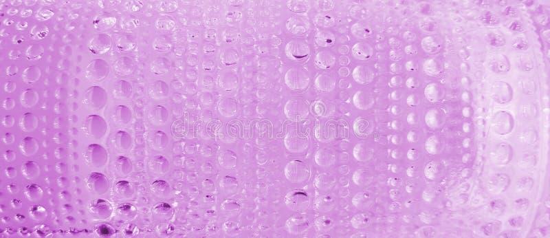 Il vetro rosa fa cadere lo sfondo della trama immagini stock libere da diritti