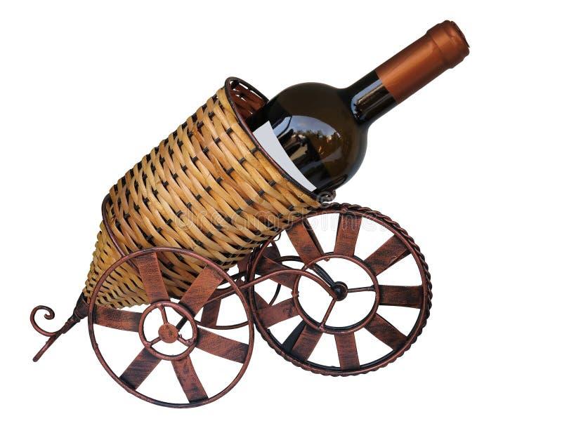Il vino imbottiglia un supporto isolato su fondo bianco fotografia stock libera da diritti