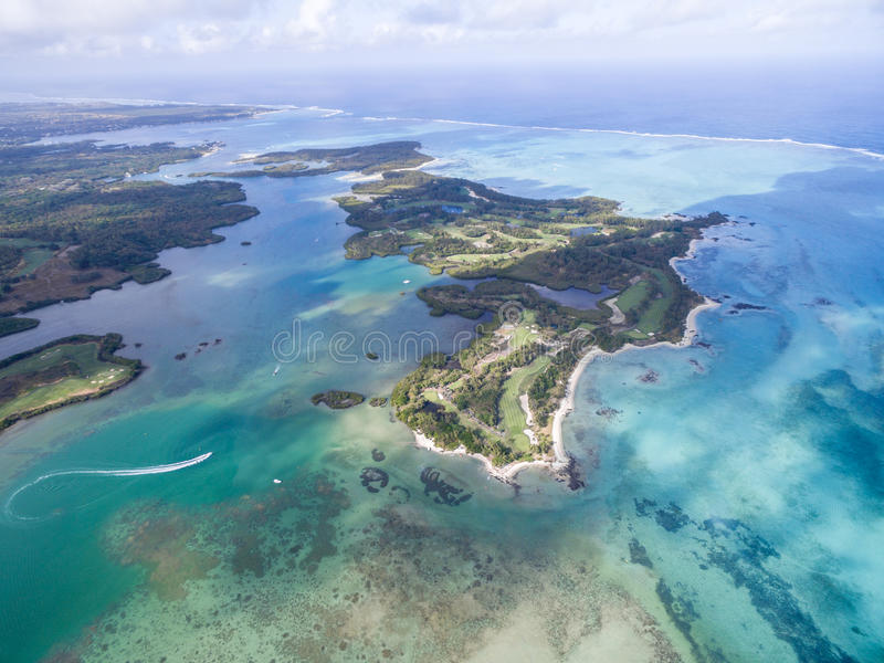 Ile aux Cerfs, Deer Island from above. Landscape with ocean and beach, yacht in background. Mauritius. Ile aux Cerfs, Deer Island from above stock photo