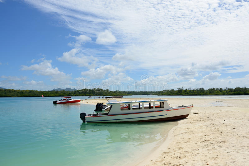 Ile Cerfs, Mauritius. Mauritius, moored boats on a beach of the island Ile Cerfs stock photography