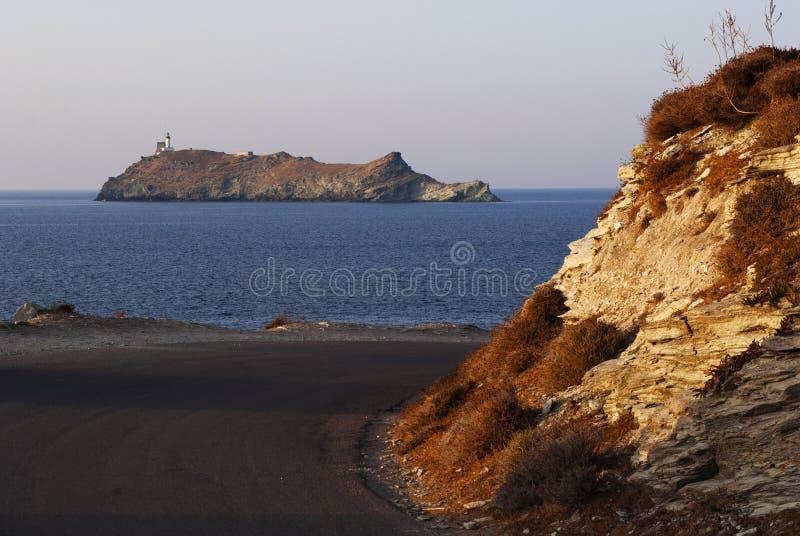 Ile de la Giraglia, Giraglia island, lighthouse, Barcaggio, Ersa, Cap Corse, Cape Corse, Haute-Corse, Corsica, France, Europe. Corsica, 29/08/2017: the road to royalty free stock photo