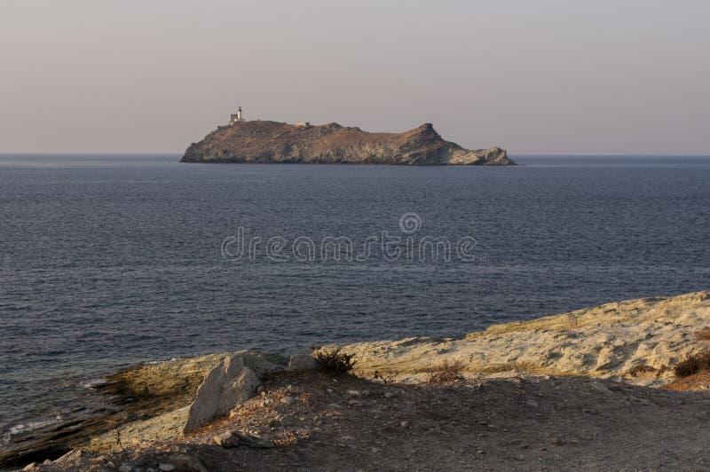 Ile De Los angeles Giraglia, Giraglia wyspa, latarnia morska, Barcaggio, Ersa, nakrętka Corse, przylądek Corse, haute-corse, Cors obraz royalty free