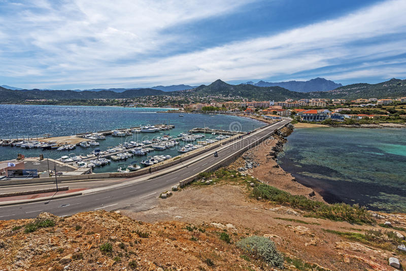 Ile-Rousse landscape seen from Pietra Islet in Corsica royalty free stock images