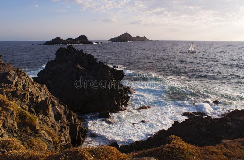 Iles Sanguinaires, Gulf of Ajaccio, Corsica, Corse, France, Europe, island. Corsica, 01/09/2017: a sailboat in the Mediterranean Sea with view of the Iles royalty free stock image