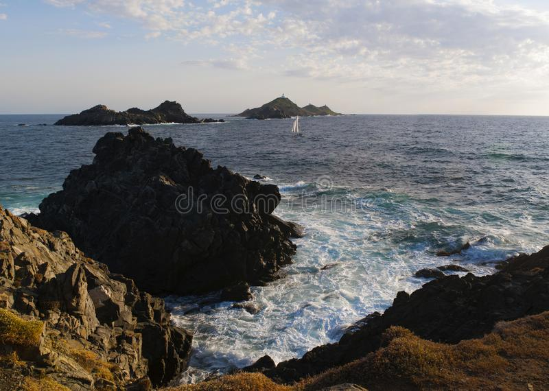 Iles Sanguinaires, Gulf of Ajaccio, Corsica, Corse, France, Europe, island. Corsica, 01/09/2017: rocks, waves and the Mediterranean Sea with view of the Iles stock photography