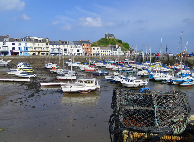 Ilfracombe harbor in North Devon England. Ilfracombe harbor in North Devon in the west country England. Showing the Chapel of St Nicholas on the hill in the royalty free stock image