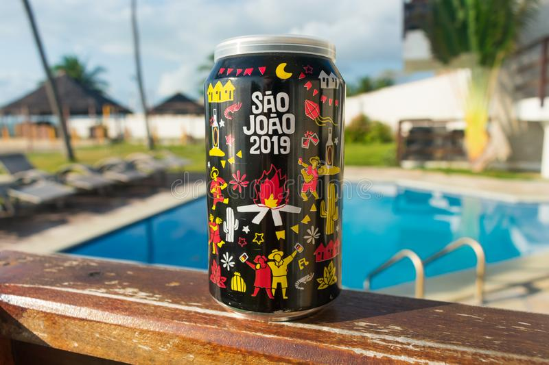 Pitu can with Sao Joao design June festivities and swimming pool in the background stock photo