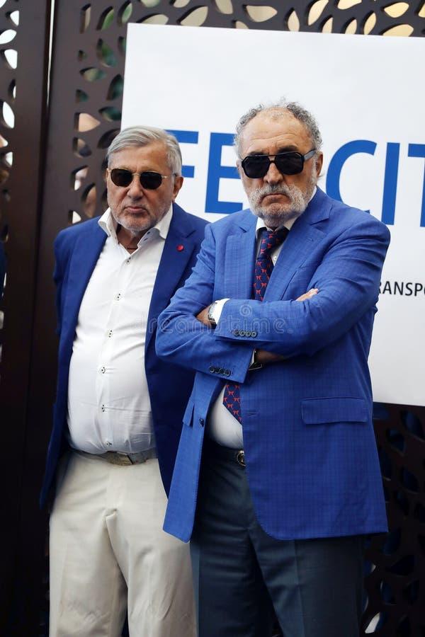 Ilie Nastase och Ion Tiriac som väntar Simona Halep royaltyfri foto