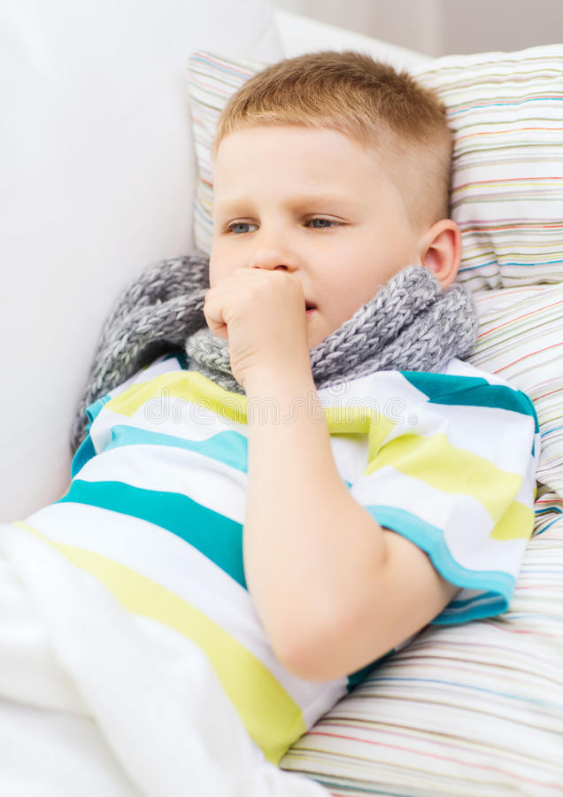 Ill boy with flu at home royalty free stock photography