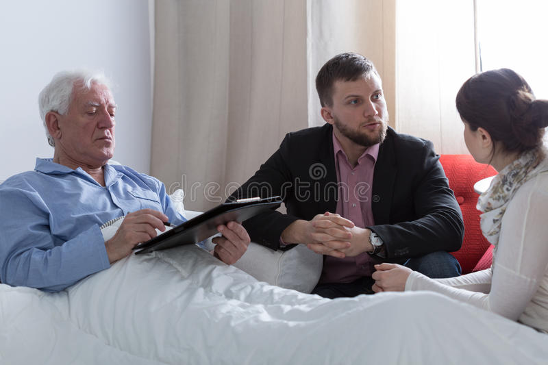 Ill father making a last will stock photos