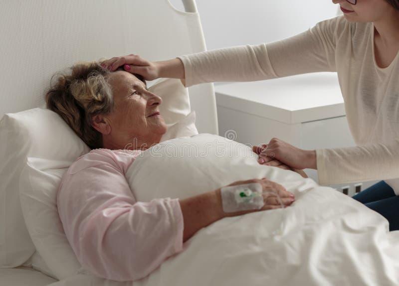 Ill grandma in hospital stock photography