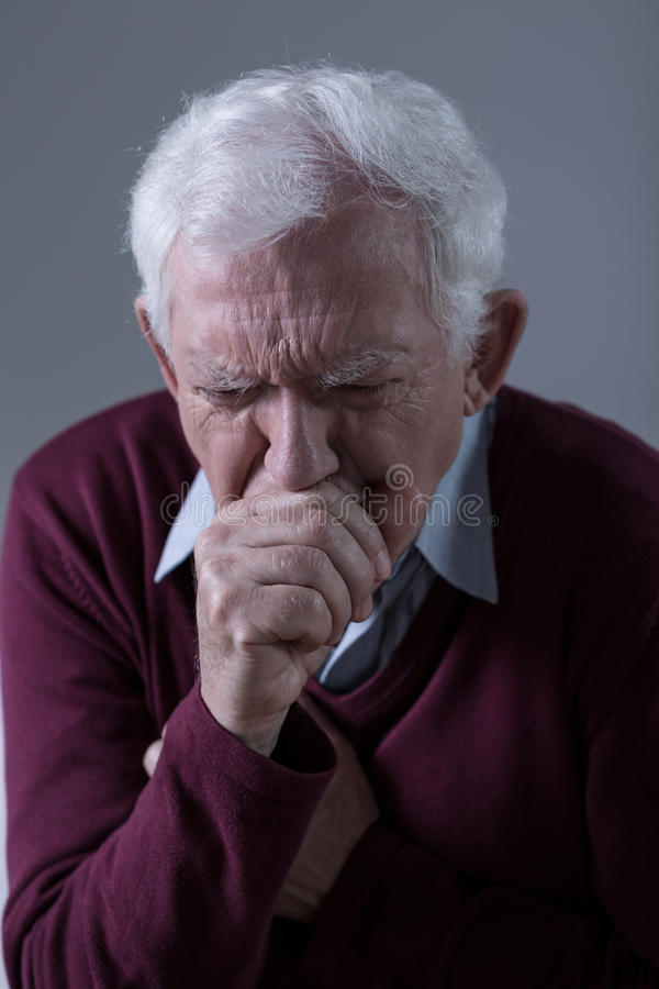 Ill man coughing royalty free stock photography