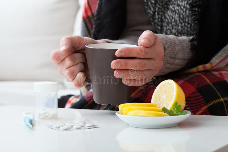 Ill man and hot drink royalty free stock images