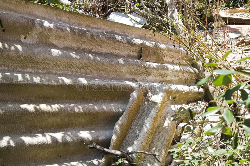 Illegal asbestos Dumping..Medical studies have shown that the asbestos particles can cause cancer.  royalty free stock photos