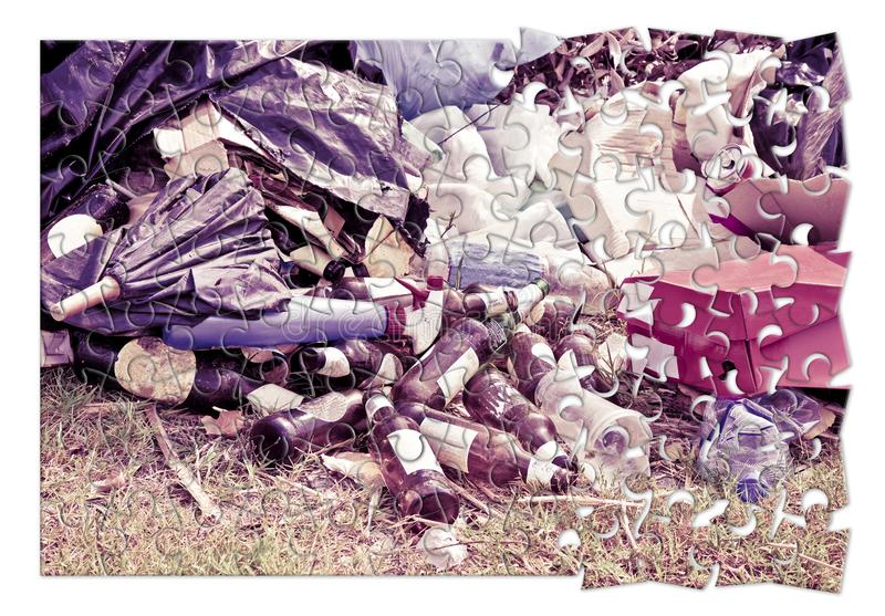 Illegal dumping in the nature - concept image in jigsaw puzzle shape stock images