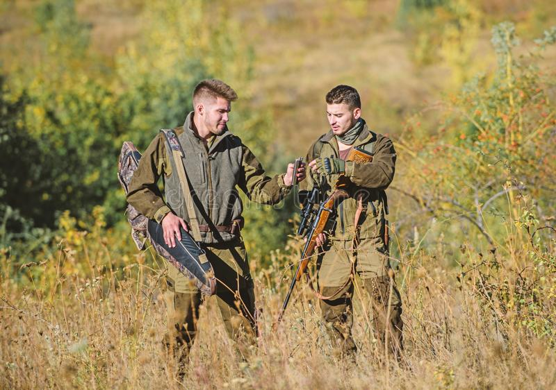 Illegal hunting. Hunters friends enjoy leisure. Poacher partner in crime. Activity for real men concept. Hunters stock photos
