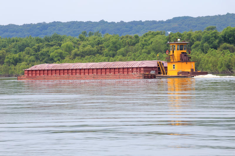 Illinois River Tug and Barge. Illinois River Barge being pushed toward the Mississippi River stock photo