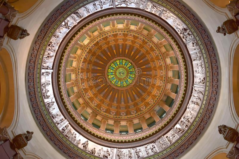 Illinois State Capitol Dome Interior. The Illinois State Capitol, located in Springfield, Illinois, houses legislative and the executive branches of the