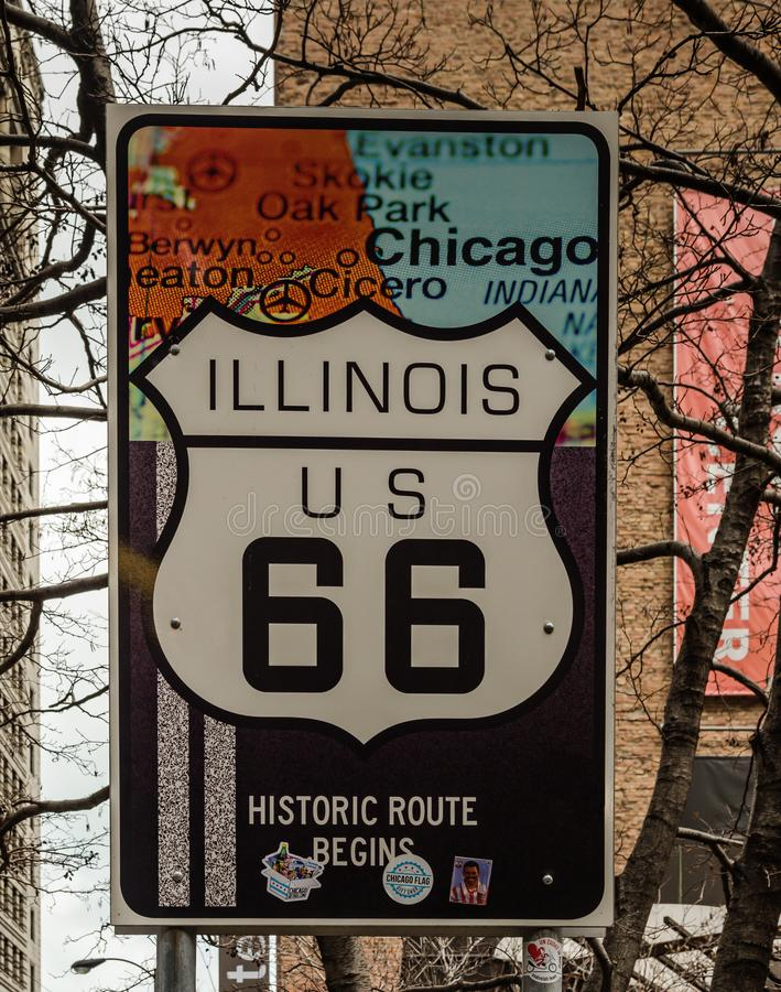 Illinois US 66 Route Sign. Chicago, Illinois / USA / March 31, 2016: Vertical shot of the famous US Route 66 in the city where it begins: Chicago, IL stock images