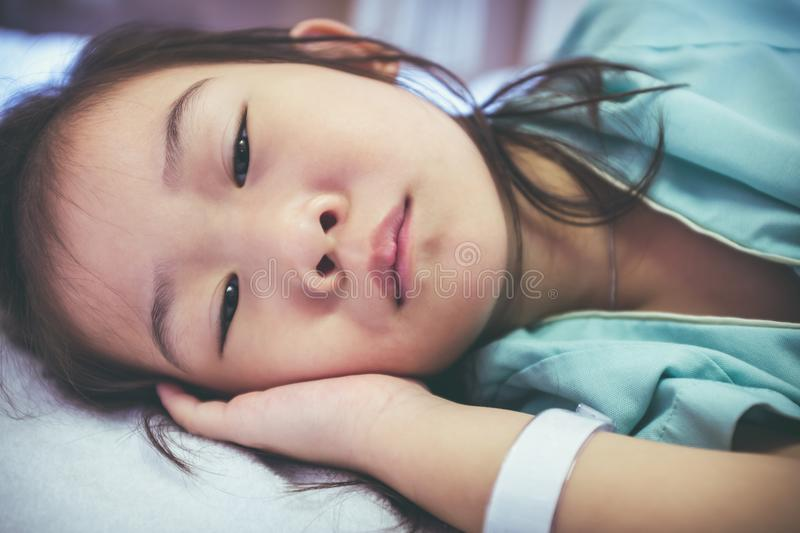 Illness asian child admitted in hospital. Health care stories. V stock photo