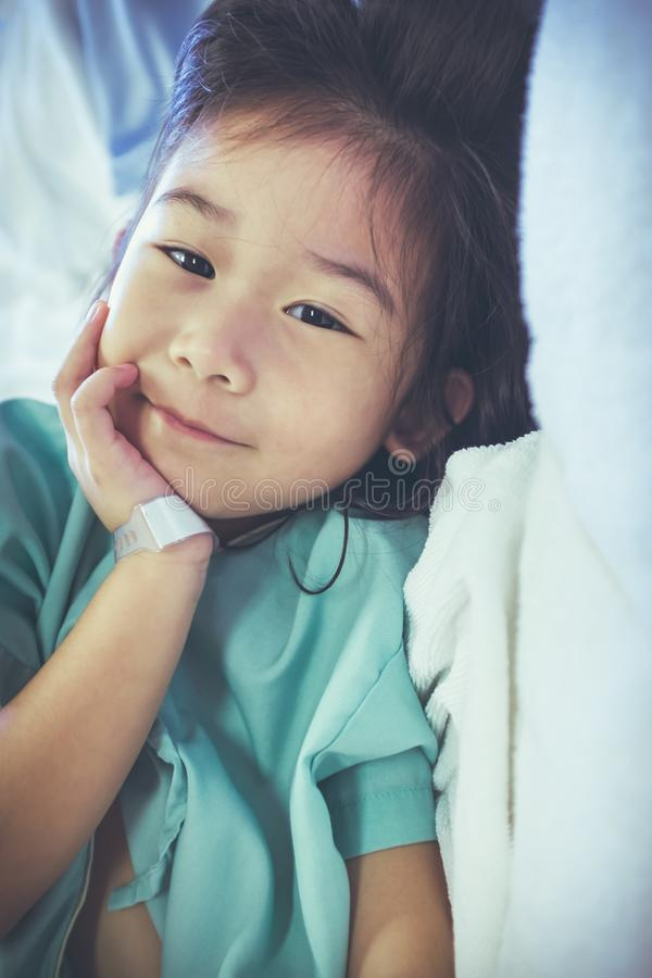 Illness asian child admitted in hospital. Health care stories. V royalty free stock photos