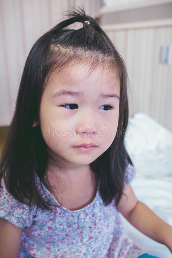 Illness asian child crying while admitted in hospital. Vintage t stock photos