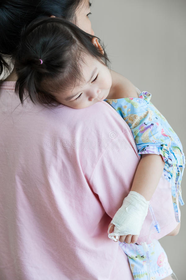 Illness child in hospital, saline intravenous (IV) on hand asian royalty free stock photos