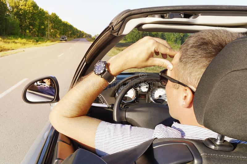 Illness, exhausted, disease, tired for overworked concept. young man holds his hand over his head in a car. businessman having royalty free stock photos