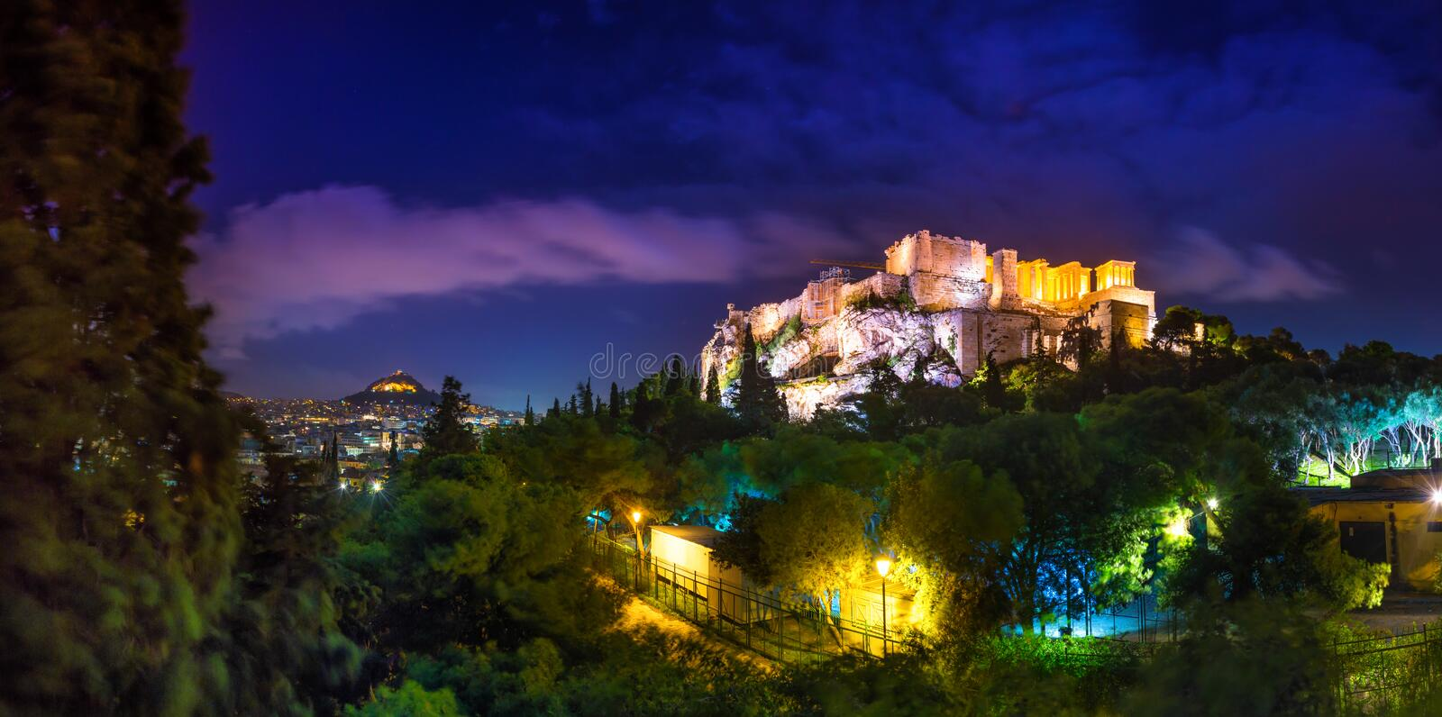 Illuminated Acropolis with Parthenon at night, Greece. stock images