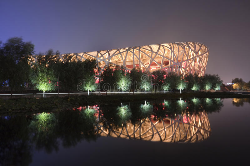 Illuminated Bird`s Nest Olympic Stadium Beijing at night stock photos