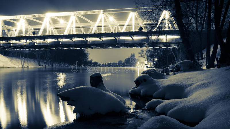 Illuminated bridge at night in winter royalty free stock image