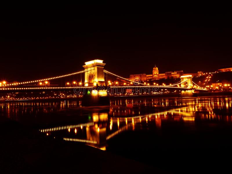 Illuminated Bridge over River at Night royalty free stock photos
