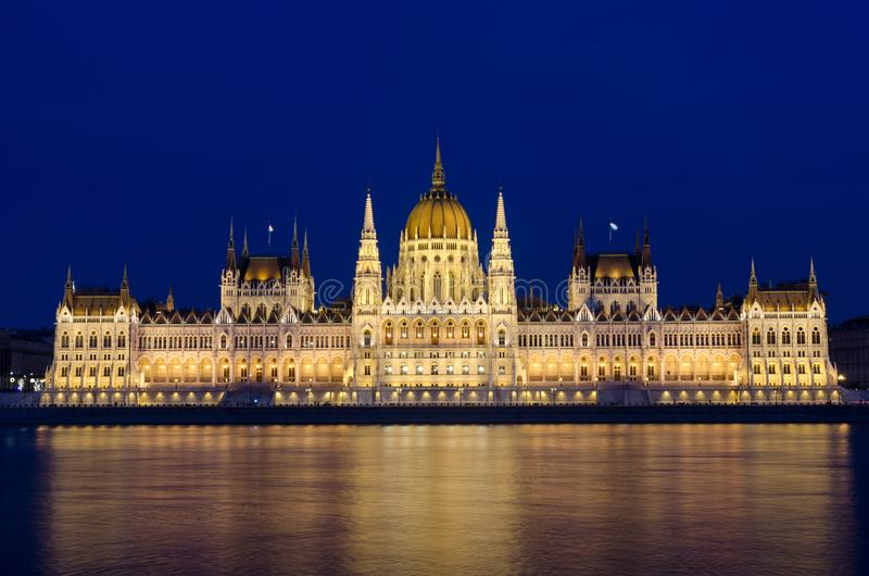Illuminated Budapest hungarian Parliament at night reflected in the Danube river.  royalty free stock photography