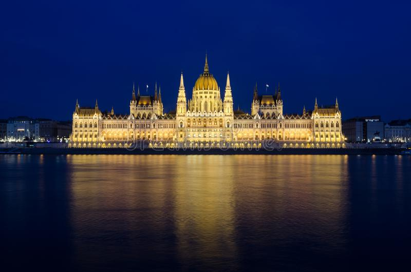 Illuminated Budapest hungarian Parliament at night reflected in the Danube river.  royalty free stock image