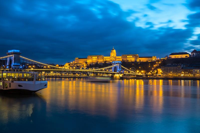 Illuminated building of Buda Castle and Chain bridge at night in Budapest. Hungary royalty free stock photography