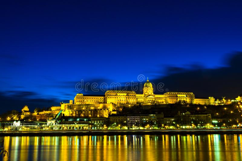 Illuminated building of Buda Castle and Chain bridge at night in. Budapest. Hungary stock image