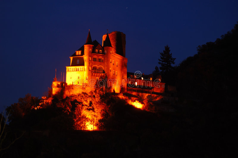 Illuminated Castle at Rhine River royalty free stock photos