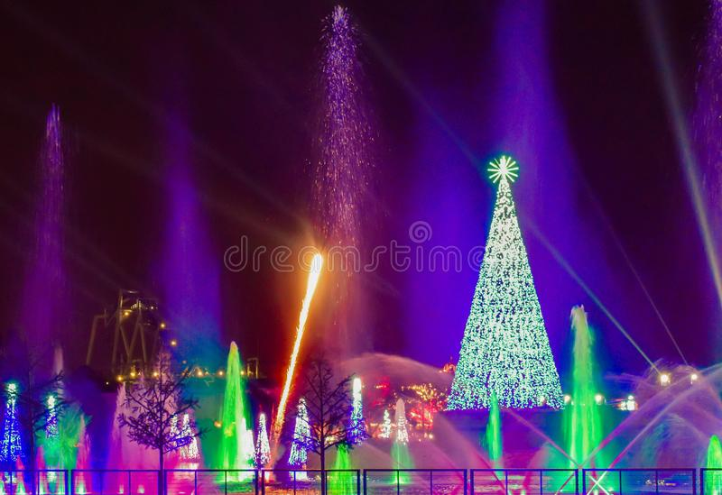 Illuminated Christmas Tree, firework and water jets at night at Seaworld. Orlando, Florida. November 22, 2018. Illuminated Christmas Tree, firework and water stock photography