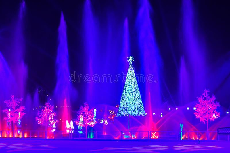 Illuminated Christmas Tree, jets of water and colorful holidays trees at Seaworld. Orlando, Florida. November 22, 2018. Illuminated Christmas Tree, jets of water royalty free stock photography