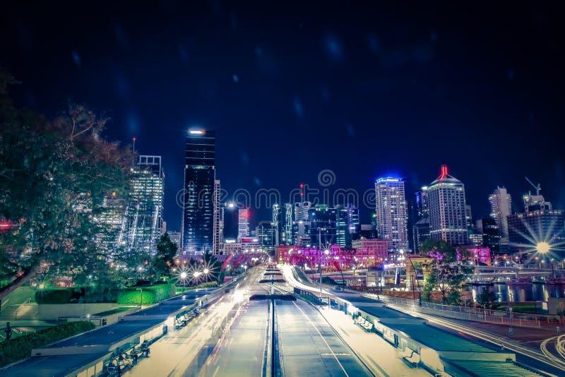 Illuminated city street in traffic lines stock photography