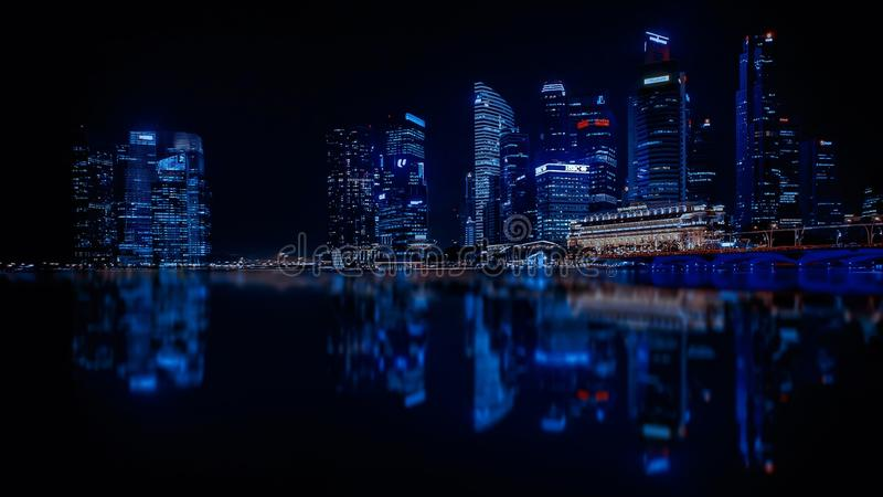Illuminated Cityscape Against Blue Sky at Night royalty free stock image