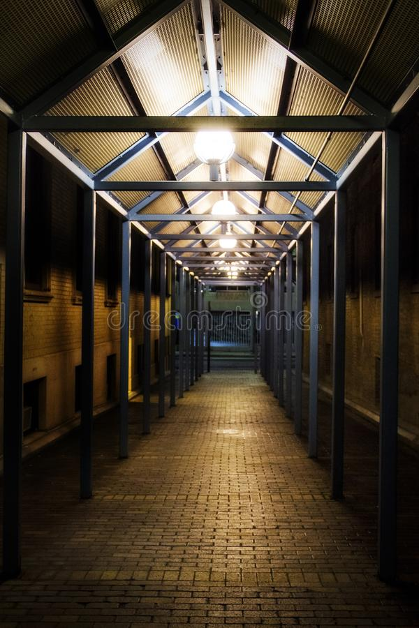Illuminated corridor at night. A picture of an illuminated corridor at night in the winter royalty free stock image