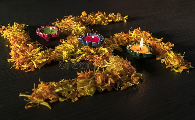 Dhanteras and diwali background.diwali greetings and wishes. Illuminated Diya/lamp placed on swastik to celebrate dhanteras and diwali festival in india royalty free stock images