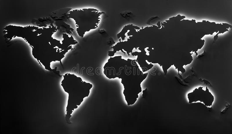 Illuminated earth map on black background. Continents shapes with cool white backlight royalty free stock images