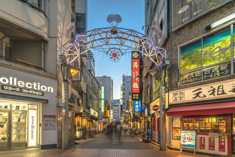 Illuminated entrance gate of the Sunshine Central Street connecting the east exit of Ikebukuro station lines with restaurants,. Shops, game center and cinemas stock photo