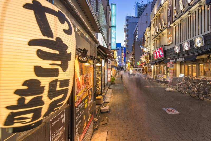 Illuminated entrance gate of the Sunshine Central Street connecting the east exit of Ikebukuro station lines with yakitori and. Sushi restaurants, shops, game stock photography