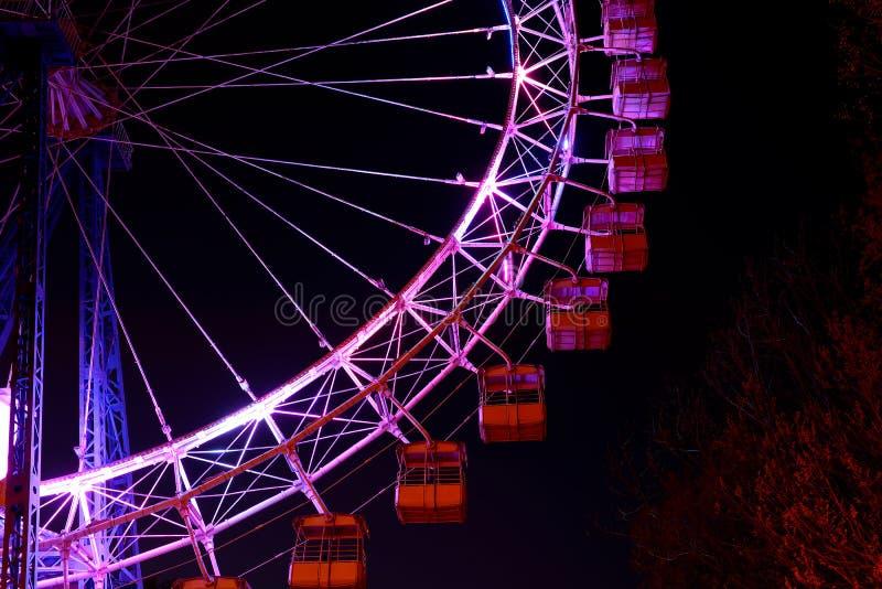 Illuminated ferris wheel in night royalty free stock photography