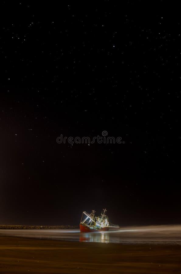 Free Illuminated Fishing Boat Stranded On Sand Beach Royalty Free Stock Photos - 159924778