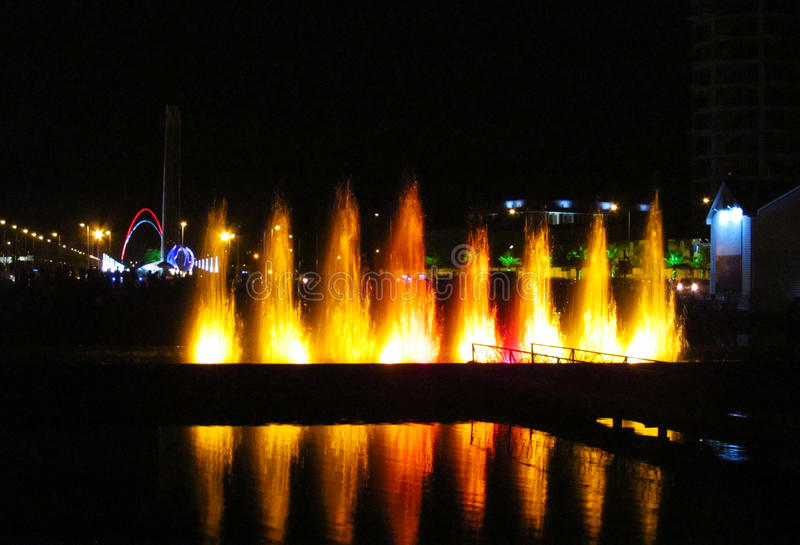 Illuminated fountain in Batumi resort, Georgia. Illumination performance at night stock photography
