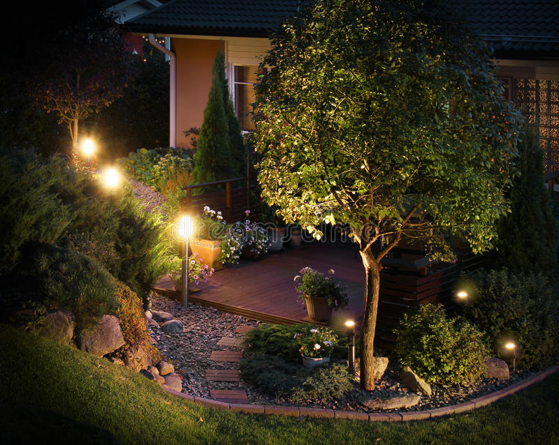 Illuminated garden path patio. Illuminated home garden path patio lights in evening dusk stock photo